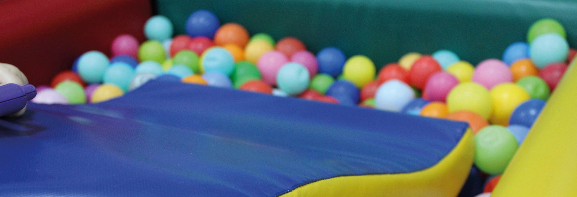 Kid friendly slide into a ballpit